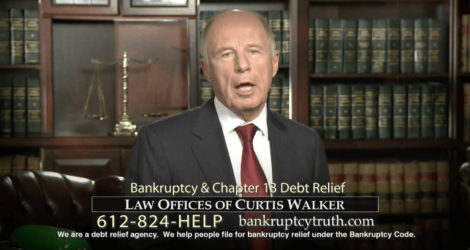 Curtis Walker stood in his office in front of a bookcase full of law books, explaining bankruptcy