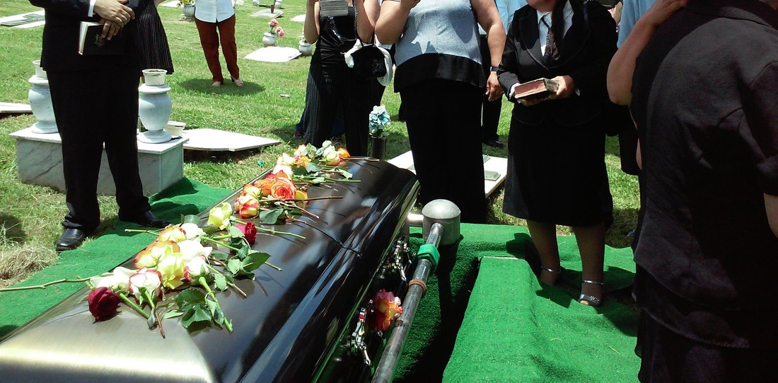 people gathered casket funeral